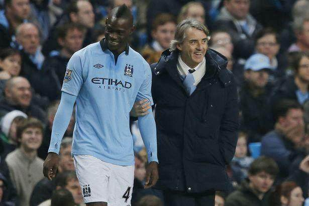 Mario-Balotelli-and-Roberto-Mancini-share-a-joke-before-he-comes-on-as-a-substitute_副本.jpg