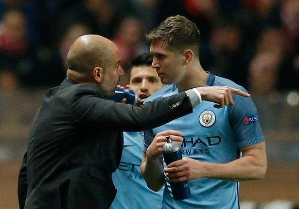 Manchester-City-manager-Pep-Guardiola-speaks-with-John-Stones.jpg