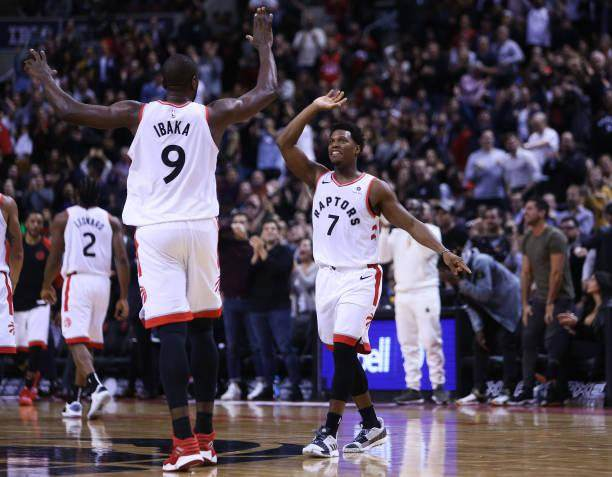 kyle-lowry-of-the-toronto-raptors-high-fives-serge-ibaka-during-the-picture-id1062311516.jpg