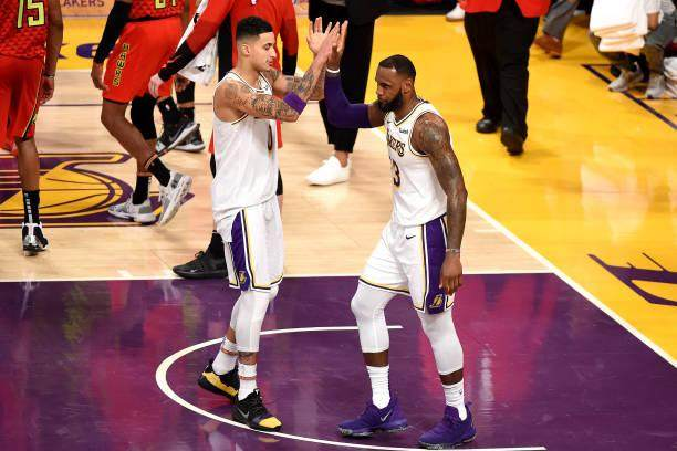 kyle-kuzma-of-the-los-angeles-lakers-hifives-lebron-james-of-the-los-picture-id1060553192.jpg