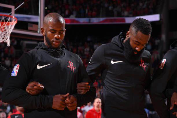 chris-paul-and-james-harden-of-the-houston-rockets-stand-for-the-a-picture-id1052426814.jpg