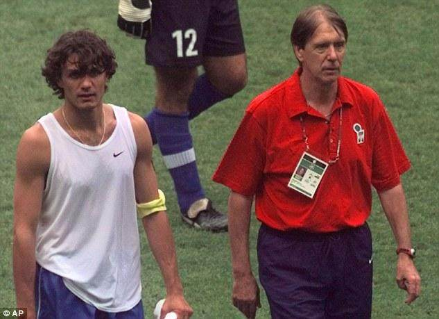 000EE66F00000258-3524514-Maldini_right_leaves_with_his_son_Paolo_after_Italy_lost_the_Wor-a-136_1459864040811.jpg