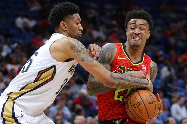 christian-wood-of-the-new-orleans-pelicans-strips-the-ball-from-john-picture-id1138509548.jpg