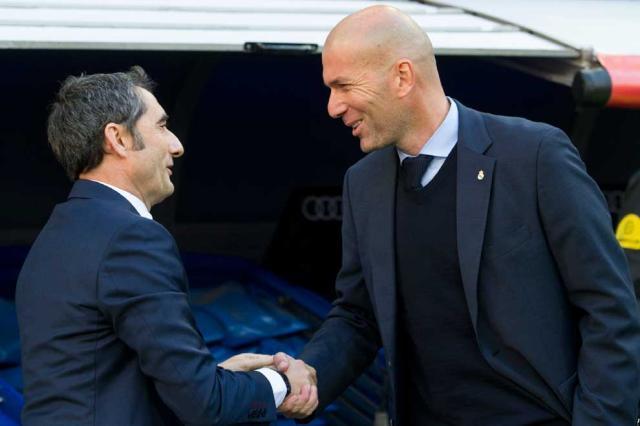 barcelona_coach_ernesto_valverde_left_shakes_hands_with_real_madrid_counterpart_zinedine_zidane_before_la_ligas_el_clasico_match_at_the_santiago_bernabeu_stadium_in_madrid_on_december_23_2017._afp.jpg
