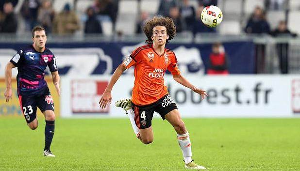 30535110-8502647-Guendouzi_playing_for_Lorient_his_first_club_during_Casoni_s_spe-a-5_1594226856918.jpg
