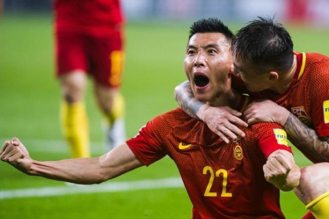 chinese-players-celebrate-after-a-major-upset-against-south-korea-in-the-world-cup-qualifiers.jpg