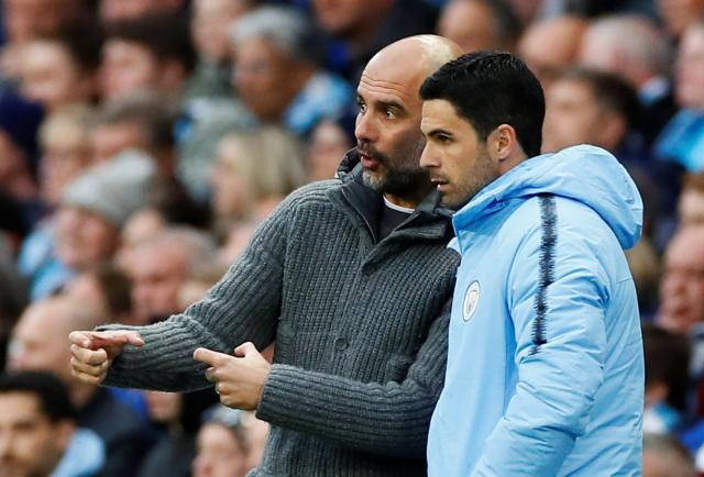 Manchester-City-manager-Pep-Guardiola-with-assistant-coach-Mikel-Arteta-.jpg