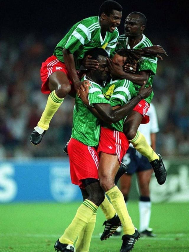 Cameroon-players-celebrate-World-Cup-1990-66a4947b19e3edead2f0a4d6803fef4d.jpg